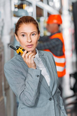female inspector with walkie talkie in shipping stock