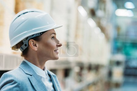 Photo for Female inspector in white helmet in warehouse - Royalty Free Image