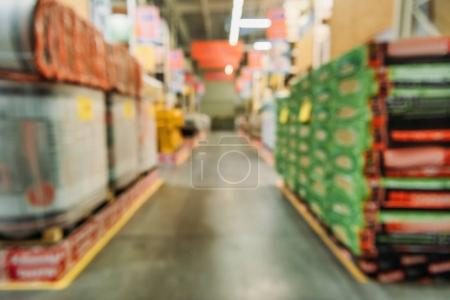 Photo for Blurred view of shelves with boxes in shipping stock - Royalty Free Image