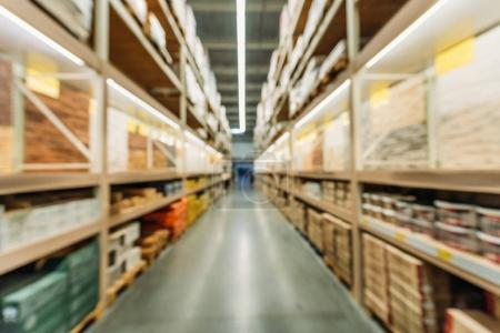 Photo pour Blurred view of shelves with boxes in storage - image libre de droit