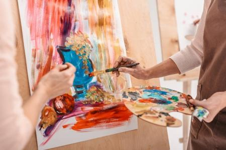 Photo for Cropped shot of artists with palette painting still life on easel - Royalty Free Image