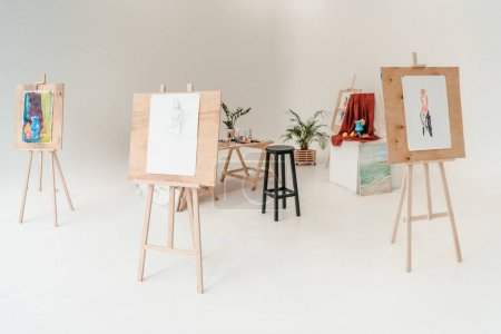 Photo for Easels with paintings in empty art studio - Royalty Free Image