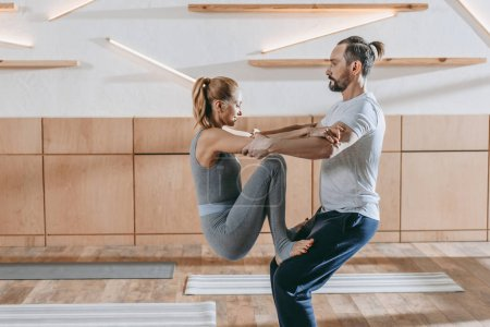 middle aged couple practicing aerobics together at training class