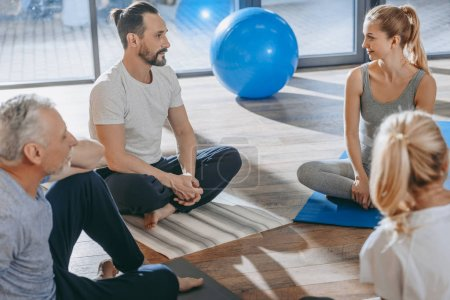 Photo for Senior people with instructor exercising together on yoga mats - Royalty Free Image