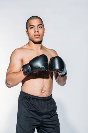 muscular african american sportsman with boxing gloves isolated on white