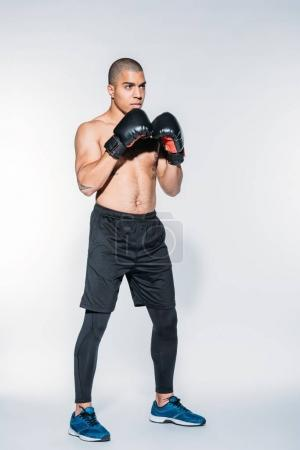 muscular african american sportsman standing in boxer stand