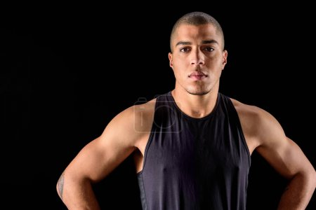 serious african american man standing isolated on black