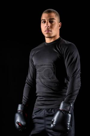 athletic african american boxer in black sportswear isolated on black