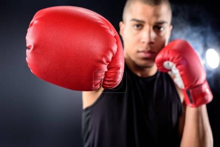 handsome african american boxer making hit on black