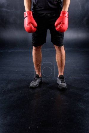cropped shot of boxer in gloves on black