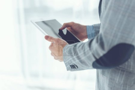 cropped image of businessman standing with tablet