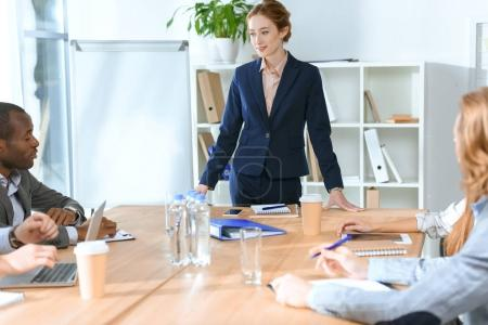 multicultural businesspeople discussing something at meeting