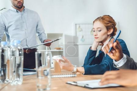 Photo for Cropped image of multicultural businesspeople sitting at meeting in office - Royalty Free Image