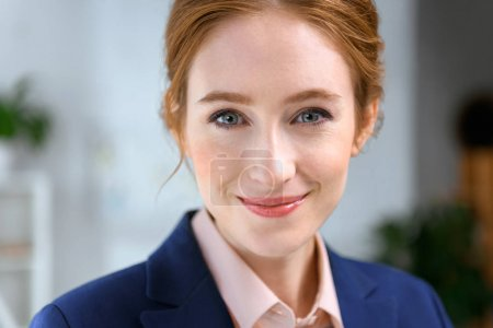 portrait of smiling businesswoman looking at camera