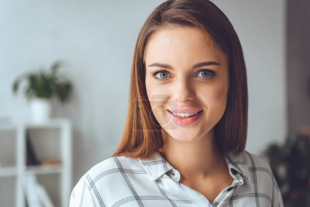 portrait of smiling caucasian woman looking at camera