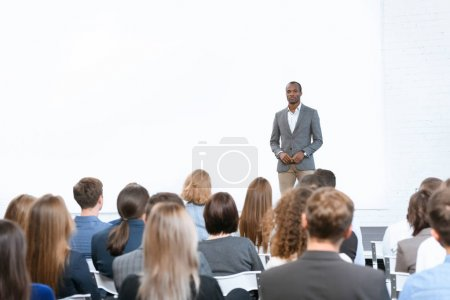african man standing against copy space at meeting