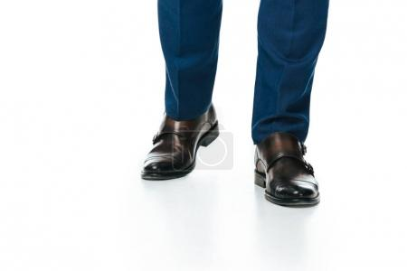 partial view of man in shoes isolated on white