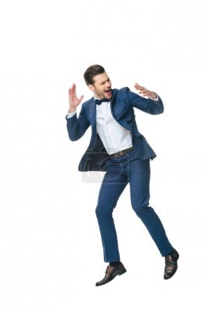 excited man in suit jumping isolated on white