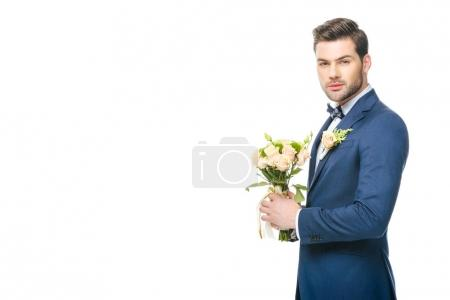 Photo for Portrait of stylish groom in suit with wedding bouquet isolated on white - Royalty Free Image