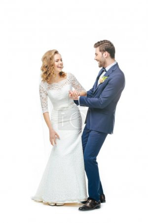 happy bride and groom looking at each other isolated on white