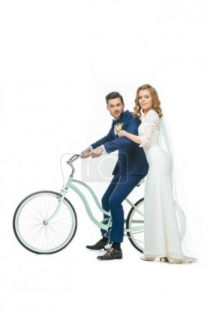 wedding couple riding retro bicycle isolated on white