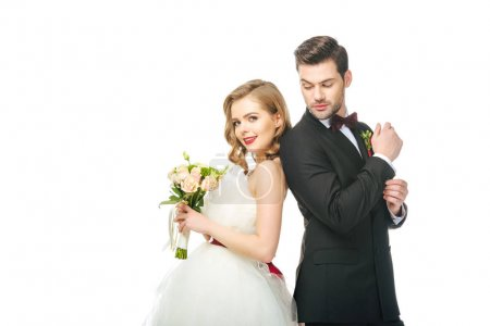 portrait of bride and groom standing back to back together isolated on white