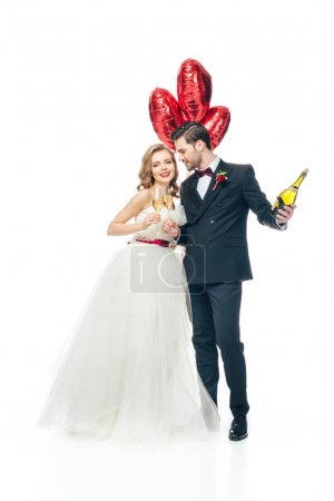 wedding couple with red heart shaped balloons and champagne isolated on white