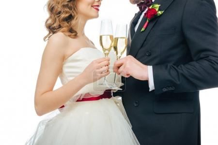 cropped shot of wedding couple with glasses of champagne isolated on white