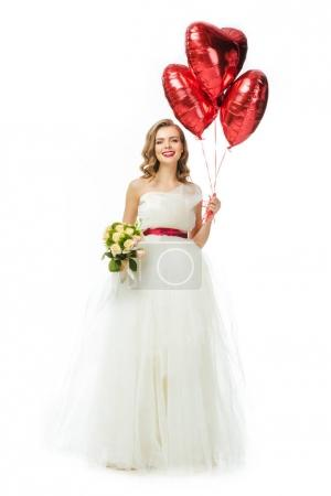 beautiful bride in wedding dress with heart shaped balloons isolated on white