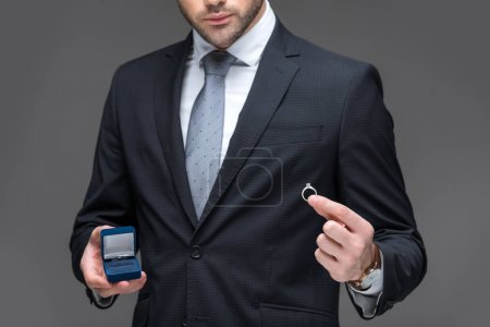 Photo for Cropped view of elegant man proposing with ring, isolated on grey - Royalty Free Image