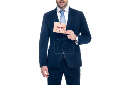 cropped view of man holding envelope for valentines day, isolated on white