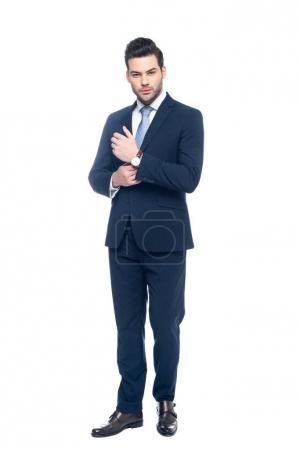 Foto de Elegante hombre de negocios posando en traje, aislada sobre fondo blanco - Imagen libre de derechos