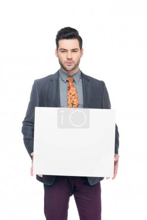 bearded businessman in suit holding blank board, isolated on white