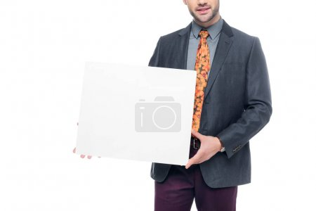 cropped view of businessman in suit holding blank placard, isolated on white