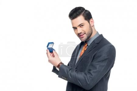 Photo for Handsome elegant man holding proposal ring, isolated on white - Royalty Free Image
