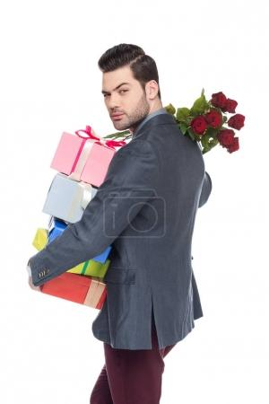 handsome man holding gifts and red roses, isolated on white