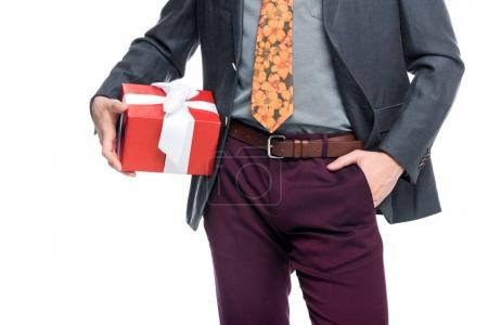 cropped view of man holding red gift box, isolated on white