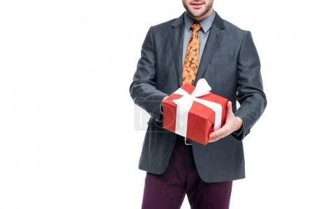 cropped view of man holding gift box, isolated on white