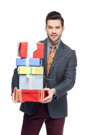 handsome man holding gift boxes, isolated on white