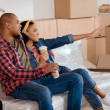 happy african american couple planning the future in new apartment