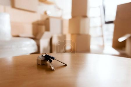 Photo for Selective focus of keys on table in new house with cardboard boxes, moving concept - Royalty Free Image