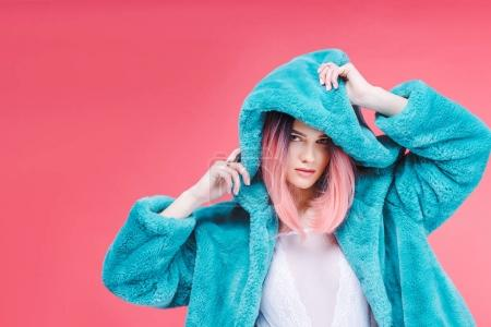 glamour model posing in lace bodysuit and trendy blue fur coat, isolated on pink