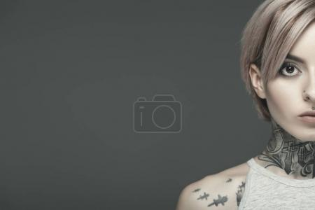 Photo for Cropped view of attractive tattooed girl, isolated on grey - Royalty Free Image
