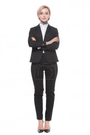 businesswoman posing in suit with crossed arms, isolated on white