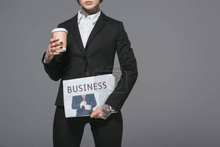Photo for Cropped view of businesswoman with coffee to go and newspaper, isolated on grey - Royalty Free Image
