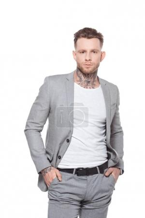 young tattooed businessman in grey suit, isolated on white