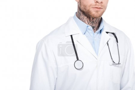 cropped view of tattooed doctor in white coat with stethoscope, isolated on white
