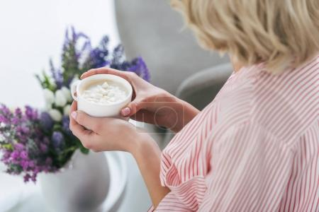 Photo for Cropped view of blonde woman holding cup of cappuccino with marshmallow - Royalty Free Image