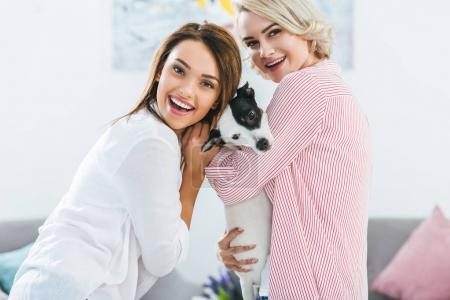 beautiful happy girls with jack russell terrier dog at home