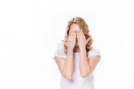obscured view of woman covering face with hands isolated on white